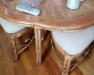 Rattan coffee table with four nesting stools