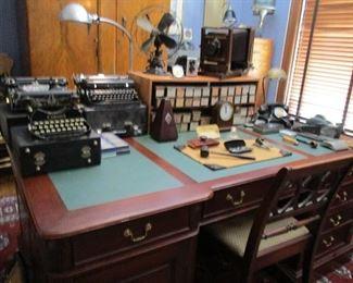 large desk & typewriters