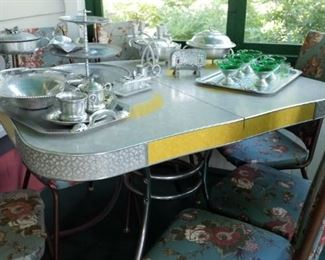 Retro kitchen table. Set of four chairs do not match table.  Lots of aluminum serving pieces.