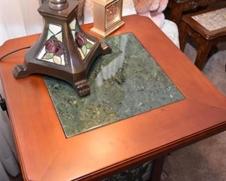 Table has stone inset on top.