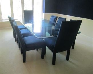 HEAVY GLASS TOP TABLE AND 8 NAVY CHAIRS