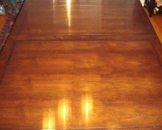 """Dining Room:  A Mid-Century dining table is shown with just one leaf in it.  The table alone measures 40"""" x 64"""" but includes three 18"""" leaves. When all of the leaves are inserted, the total measurements become 40"""" x 118."""""""