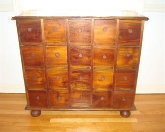 """Dining Room:  An antique 20-drawer apothecary chest rests on bun feet.  It's also great for storing notions, dried herbs, scrapbooking items, fishing lures, or whatever you need to keep nice, neat and sorted!  It measures 35"""" wide x 15"""" deep x 33"""" tall."""