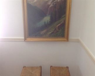 Dining Room:   An original oil painting by listed artist OLIVE BAGG DYE hangs above two [of four] antique rush seat benches.  Closer photos of the painting follow.