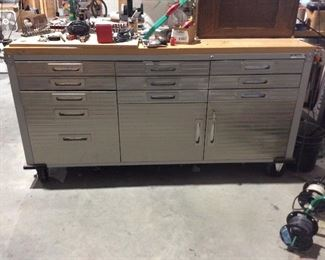 Super nice work bench has chrome face and solid wood top, on wheels and easy to move, lots of storage space