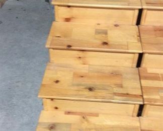 Two sets of wooden steps, each step lips off with a hidden compartment for lots of storage