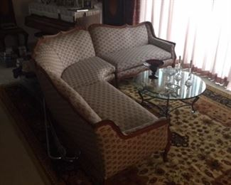 Antique sofa and modern glass table