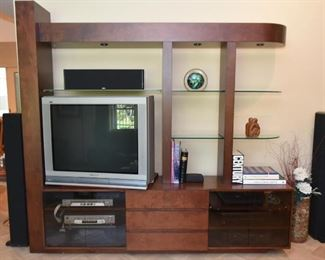 Contemporary Entertainment Unit with Overhead Lights and Glass Shelves