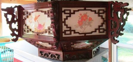 Large Oriental hanging decorative pieces.   We have 5 of these.
