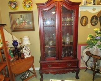 "China cabinet and other items in the ""she"" shed"