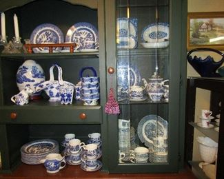 "Picture of Blue Willow in china cabinet in ""she"" shed"
