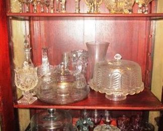 "Close-up view of items in ""she"" shed china cabine"