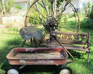 "Vintage Radio Flyer 90 wagon, bench,  and two  vintage farm implement 52"" wheels."