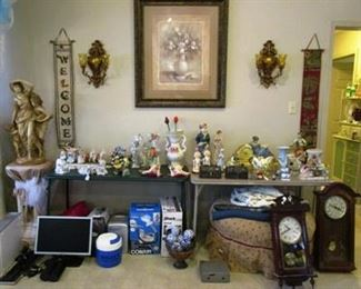 lots of figurines, wall clock, statue on pedestal, etc.
