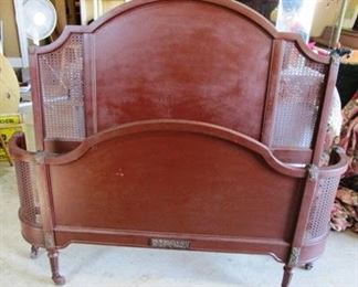Vintage metal bed with metal mesh in headboard and curved footboard