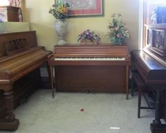 Three pianos.  One is Kimball; one is Wurlitzer; other unknown name