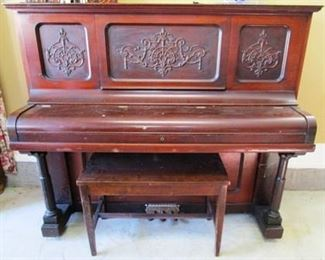 Vintage Wurlitzer piano with bench  close-up view