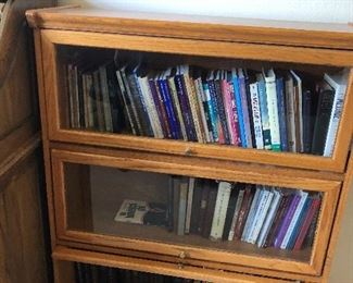 2 matching glass front bookcases.  Lots of hard back and paper back books are included in the sale.  This shows a very small portion of the books