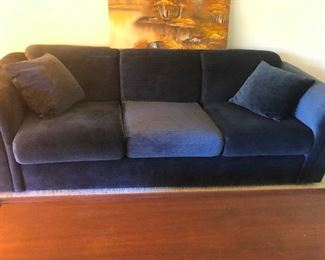 velour sofa from the set of the 80s show Dynasty
