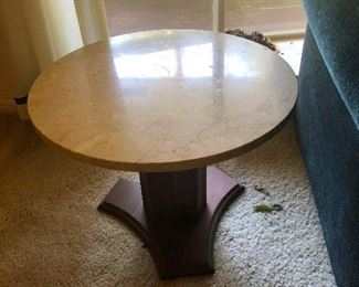 Round table top with thick fish-hook base