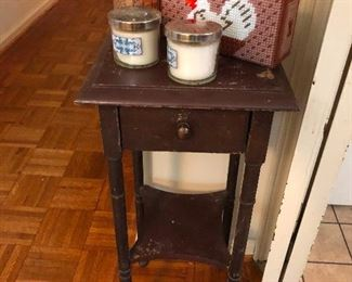 sad side table wishes rooster purse would tell candles to kindly climb off its head