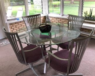 Very nice glass top table and 4 chairs.