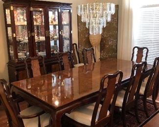 Gorgeous Asian style formal dining table with 10 chairs. China Cabinet and server