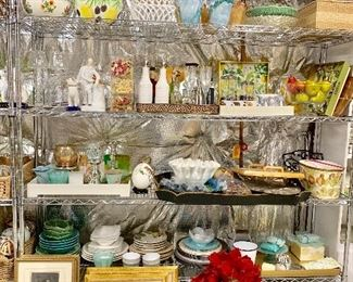 Staging supplies including framed art, artificial flowers, flower pots, glassware, accessories