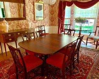 Kindel flame mahogany double pedestal dining table and 10 chairs.