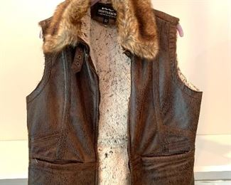 Montanaco leather vest; Shoes are 9.5-10 Clothes range from S-L. Most 8/10 and M/L