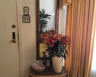 Wall mirror and table with decor