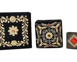 67. Two Upholstered Decorative Boxes and a Compact