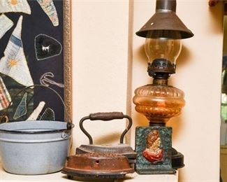 212. Oil Lamp wCast Iron Clothing Irons Bookend