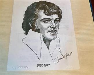 """Elvis"" print in scrape book"