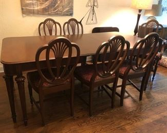 Antique dining room table (shown with leaf), 6 chairs and leafs
