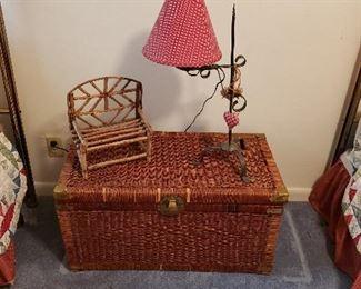 twin brass headboards, comforter sets, wicker trunk, lamp