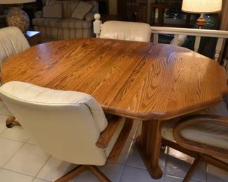 OAK DINING TABLE W/4 ROLLING CHAIRS