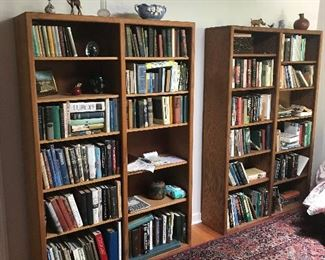 two matching double oak bookcases-books