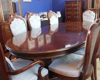"""Karges oval shaped dining room table and 8 chairs. Shown here with one leaf and measures 92"""" long, comes with two additional 20"""" leaves. This table is immaculate."""