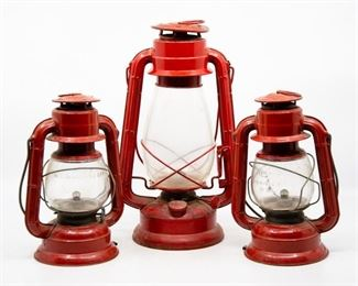 Lot 4. Set of 3 red railroad lanterns. Metal and glass. Two are Dietz brand Comet models (Made in USA), the other is Winged Wheel (Made in Japan).