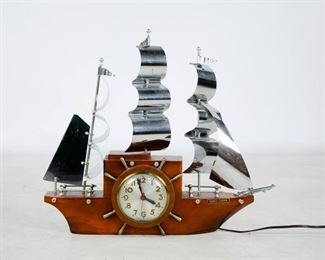 "Lot 26. Ship Clock. Made by Mastercrafters in Chicago is this ships clock. Made of wood and metal. Has electrical cord. 16"" H x 19.5"" W x 4"" D."