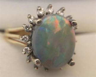 Semi Black Opal and Diamond Ring https://ctbids.com/#!/description/share/225528