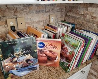 Very large selection of colorful cook books