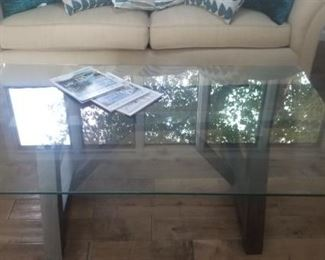 """Glass Topped Large Cocktail table wood base.. 56""""x36"""" $150.00"""
