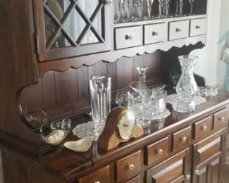 breakfront and tons of glassware, including waterford