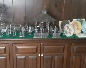 wooden cabinet filled and topped with collectibles, pewter, plates etc