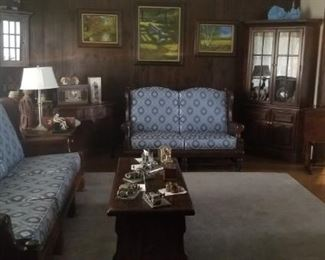 vintage wooden sofa and love cushioned with lots of wood furniture accents
