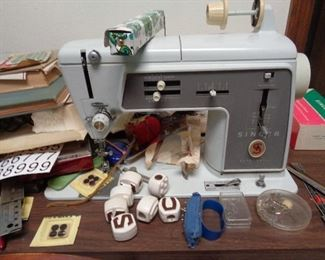 sewing machine in cabinet w/notions & some fabric