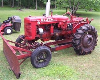 THIS IS A 1948/49 FARMALL TRACTOR WITH PLOW