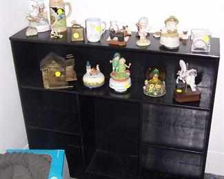BLACK BOOKCASE AND FIGURINES